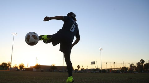 <p>               Freddy Sebastian, 20, originally from Guatemala, warms up prior to playing in a Maya Chapin soccer league game Wednesday, April 17, 2019, in Phoenix. As Guatemalans and other Central Americans flood to the U.S.-Mexico border, groups like the Maya Chapin youth soccer group in Phoenix are providing support for young people arriving alone or with families. (AP Photo/Ross D. Franklin)             </p>