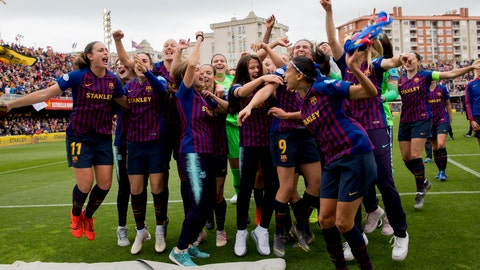 <p>               FC Barcelona players celebrate at the end of the Women's Champions League semifinal second leg soccer match between FC Barcelona and Bayern Munich at the Miniestadi stadium in Barcelona, Spain, Sunday, April 28, 2019. (AP Photo/Joan Monfort)             </p>