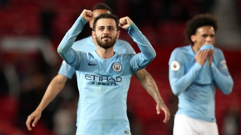 <p>               Manchester City's Bernardo Silva and Leroy Sane, right, celebrate at the end of the English Premier League soccer match between Manchester United and Manchester City at Old Trafford Stadium in Manchester, England, Wednesday April 24, 2019. Manchester City won 2-0. (AP Photo/Jon Super)             </p>