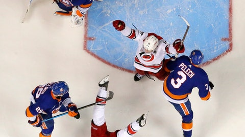 <p>               Carolina Hurricanes right wing Nino Niederreiter, bottom, of Switzerland, falls back while celebrating his third-period goal with teammate center Jordan Staal, center, during the third period of Game 2 of an NHL hockey second-round playoff series against the New York Islanders, Sunday, April 28, 2019, in New York. Islanders goaltender Robin Lehner (40), of Sweden, center Brock Nelson (29) and defenseman Adam Pelech (3) look on during the celebration. The Hurricanes won 2-1. (AP Photo/Julio Cortez)             </p>