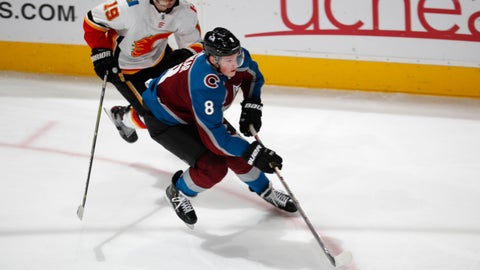 <p>               Colorado Avalanche defenseman Cale Makar, front, drives down the ice with the puck past Calgary Flames left wing Matthew Tkachuk during the third period of Game 4 of an NHL hockey playoff series Wednesday, April 17, 2019, in Denver. The Avalanche won 3-2 in overtime. (AP Photo/David Zalubowski)             </p>