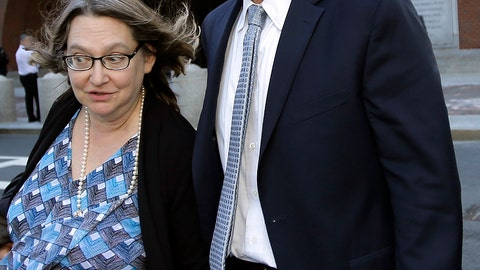 <p>               Michael Center, right, former men's tennis coach at the University of Texas at Austin, departs federal court with an unidentified woman, Wednesday, April 24, 2019, in Boston, after he pled guilty to charges in a nationwide college admissions bribery scandal. (AP Photo/Steven Senne)             </p>
