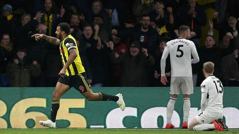 <p>               Watford's Troy Deeney, left, celebrates scoring his side's third goal of the game as Fulham's Calum Chambers, second right, and Tim Ream appear dejected during their English Premier League soccer match at Vicarage Road, Watford, England, Tuesday, April 2, 2019. (Nigel French/PA via AP)             </p>
