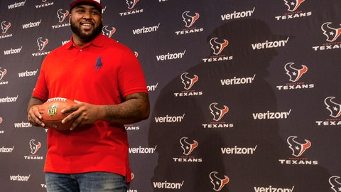 <p>               Houston Texans top draft pick Tytus Howard poses for photos with a football following an introductory NFL news conference Friday, April 26, 2019, in Houston. Howard was an offensive lineman for Alabama State. (Brett Coomer/Houston Chronicle via AP)             </p>