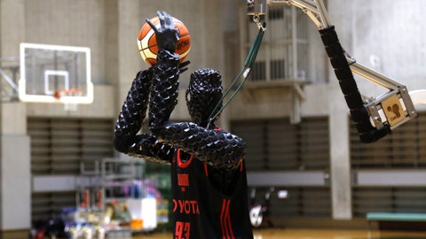 <p>               Toyota's basketball robot Cue 3 demonstrates Monday, April 1, 2019 at a gymnasium in Fuchu, Tokyo. The 207-centimeter (six-foot-10) -tall machine made five of eight three-pointer shots in a demonstration in a Tokyo suburb Monday, a ratio its engineers say is worse than usual. Toyota Motor Corp.'s robot, called Cue 3, computes as a three-dimensional image where the basket is, using sensors on its torso, and adjusts motors inside its arm and knees to give the shot the right angle and propulsion for a swish.(AP Photo/Yuri Kageyama)             </p>