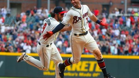 <p>               Atlanta Braves' Dansby Swanson is chased by Charlie Culberson, left, after Swanson hit a one run single RBI in the ninth inning to end a baseball game against the Miami Marlins, Sunday, April 7, 2019, in Atlanta. (AP Photo/John Amis)             </p>