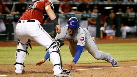 <p>               Chicago Cubs' Willson Contreras, right, attempts to steal home as Arizona Diamondbacks catcher Carson Kelly waits to make the tag during the 13th inning of a baseball game, Sunday, April 28, 2019, in Phoenix. Contreras was out on the play. (AP Photo/Ralph Freso)             </p>