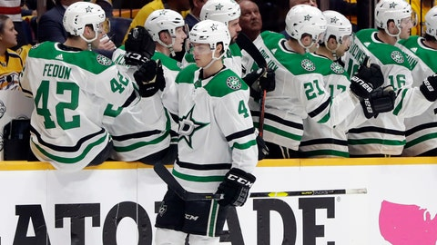 <p>               Dallas Stars defenseman Miro Heiskanen (4), of Finland, is congratulated after scoring a goal against the Nashville Predators during the second period in Game 1 of an NHL hockey first-round playoff series Wednesday, April 10, 2019, in Nashville, Tenn. (AP Photo/Mark Humphrey)             </p>