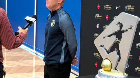 "<p>               In this photo Sept. 20, 2018, file photo, North Carolina Courage coach Paul Riley is interviewed by a reporter next to the trophy for the National Women's Soccer League championship during a media event at Nike in Beaverton, Ore. The National Women's Soccer League opens its seventh season this weekend with lingering some questions about the overall health of the league but the encouraging possibility of a World Cup ""bump."" (AP Photo/Anne M. Peterson, File)             </p>"