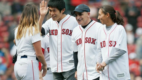 <p>               2018 Boston Marathon winners Yuki Kawauchi, left, and Desiree Linden, right, walk off the field with race sponsor John Hancock's Rob Freidman, center, after throwing out the ceremonial first pitch before a baseball game between the Boston Red Sox and the Baltimore Orioles in Boston, Saturday, April 13, 2019. (AP Photo/Michael Dwyer)             </p>