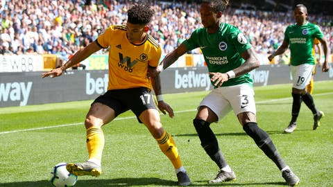 <p>               Wolverhampton Wanderers' Morgan Gibbs-White, left, and Brighton & Hove Albion's Gaetan Bong battle for the ball during the English Premier League soccer match between Wolverhampton Wanders and Brighton and Hove Albion at the Molineux stadium, Wolverhampton, England. Saturday, April 20, 2019 (Nick Potts/PA via AP)             </p>