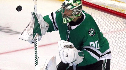 <p>               Dallas Stars goaltender Ben Bishop (30) deflects a shot by the Minnesota Wild in the third period of an NHL hockey game Saturday, April 6, 2019, in Dallas. (AP Photo/Richard W. Rodriguez)             </p>