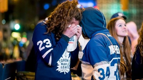 <p>               Fans react in Toronto on Tuesday, April 23, 2019, as the Toronto Maple Leafs lose to the Boston Bruins 5-1 and are eliminated from the Stanley Cup playoffs. Fans watched the action from Boston on large outdoor screens in Maple Leaf Square in Toronto. (Christopher Katsarov/The Canadian Press via AP)             </p>