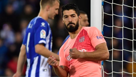 <p>               Barcelona forward Luis Suarez celebrates scoring his side's 2nd goal, during a Spanish La Liga soccer match between Deportivo Alaves and FC Barcelona at the Medizorrosa stadium in Vitoria, Spain, Tuesday, April 23, 2019. (AP Photo/Alvaro Barrientos)             </p>