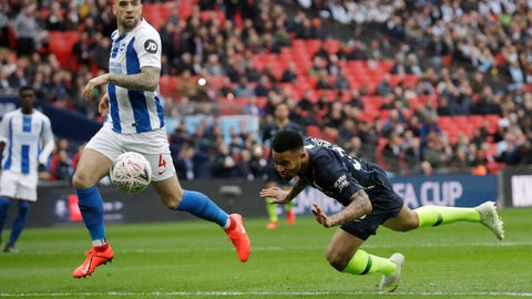 <p>               Manchester City's Gabriel Jesus scores the opening goal during the English FA Cup semifinal soccer match between Manchester City and Brighton & Hove Albion at Wembley Stadium in London, Saturday, April 6, 2019. (AP Photo/Matt Dunham)             </p>
