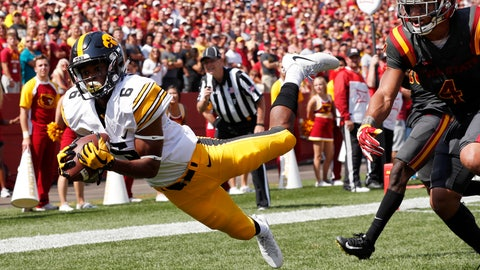 <p>               FILE - In this Sept. 9, 2017, file photo, Iowa wide receiver Ihmir Smith-Marsette (6) catches a 15-yard touchdown pass ahead of Iowa State defensive back Evrett Edwards, right, during the second half of an NCAA college football game, in Ames, Iowa. Iowa knows it'll have to revamp its tight-end focused offense in 2019 after losing two of the best in school history to the NFL. Brandon Smith and Imhir Smith-Marsette will likely be the major benefactors of T.J. Hockenson and Noah Fant's departures. (AP Photo/Charlie Neibergall, File)             </p>