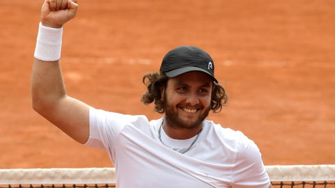 <p>               FILE - In this May 28, 2018 file photo, Argentina's Marco Trungelliti riases his fist after defeating Australia's Bernard Tomic during their first round match of the French Open tennis tournament at the Roland Garros stadium in Paris. Blowing the whistle on betting-related corruption that is eating at tennis' credibility has come at a cost for the Argentine whose mad-dash road trip to Roland Garros last year caused a sensation. (AP Photo/Alessandra Tarantino, File)             </p>