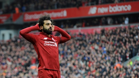 <p>               Liverpool's Mohamed Salah celebrates after scoring his side's second goal during the English Premier League soccer match between Liverpool and Chelsea at Anfield stadium in Liverpool, England, Sunday, April 14, 2019. (AP Photo/Rui Vieira)             </p>