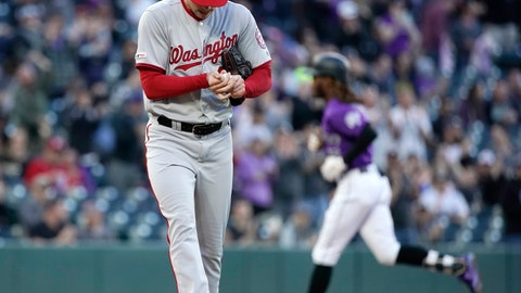 <p>               Washington Nationals starting pitcher Patrick Corbin hangs his head after giving up a two run home run to Colorado Rockies' Raimel Tapia, back,during the second inning of a baseball game Tuesday, April 23, 2019, in Denver. (AP Photo/Jack Dempsey)             </p>