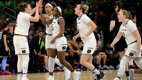 <p>               Notre Dame's Jackie Young (5) celebrates with her teammates after scoring a basket during the second half of a regional championship game against Stanford in the NCAA women's college basketball tournament, Monday, April 1, 2019, in Chicago. (AP Photo/Nam Y. Huh)             </p>