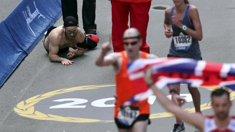 <p>               Micah Herndon, of Tallmadge, Ohio, crawls to the finish line in the 123rd Boston Marathon on Monday, April 15, 2019, in Boston. (AP Photo/Charles Krupa)             </p>
