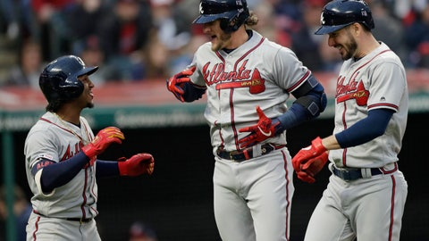 <p>               Atlanta Braves' Josh Donaldson, center, is congratulated by Ozzie Albies, left, and Matt Joyce after Donaldson hit a three-run home run in the second inning of a baseball game against the Cleveland Indians, Sunday, April 21, 2019, in Cleveland. Albies and Joyce scored on the play. (AP Photo/Tony Dejak)             </p>