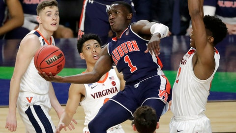<p>               Auburn's Jared Harper (1) takes a shot during the second half in the semifinals of the Final Four NCAA college basketball tournament against the Virginia, Saturday, April 6, 2019, in Minneapolis. (AP Photo/Matt York)             </p>
