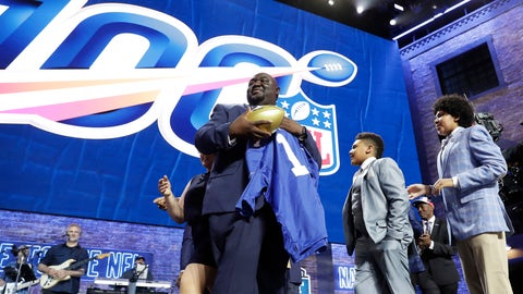 <p>               New York Giants fan Greg Hampton, holds a jersey after winning two season tickets for the team for the next century, during in the first round at the NFL football draft, Thursday, April 25, 2019, in Nashville, Tenn. As part of the NFL's celebration of its 100th season, which begins in September, the league held a contest that drew about 5,000 entrants. (AP Photo/Mark Humphrey)             </p>