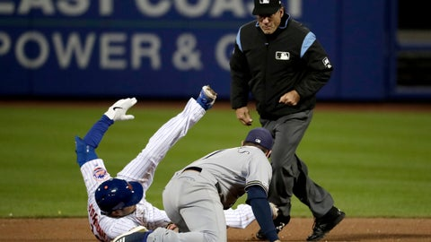 <p>               Second base umpire Phil Cuzzi, top, looks on as New York Mets' Travis d'Arnaud, left, is tagged out by Milwaukee Brewers second baseman Mike Moustakas, center, while trying to stretch a single off relief pitcher Alex Wilson during the seventh inning of a baseball game, Saturday, April 27, 2019, in New York. (AP Photo/Julio Cortez)             </p>