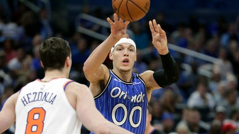 <p>               Orlando Magic's Aaron Gordon (00) passes the ball over New York Knicks' Mario Hezonja (8) during the second half of an NBA basketball game Wednesday, April 3, 2019, in Orlando, Fla. (AP Photo/John Raoux)             </p>