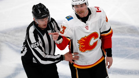 <p>               Referee Steve Kozari, left, escorts Calgary Flames center Sam Bennett to the bench as he points to the Colorado Avalanche team box when players taunt Bennett after his fight with Colorado left wing Matt Calvert in the third period of Game 3 of a first-round NHL hockey playoff series, Monday, April 15, 2019, in Denver. The Avalanche won 6-2. (AP Photo/David Zalubowski)             </p>