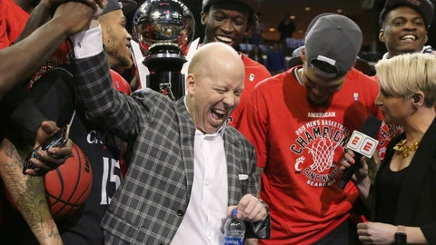 <p>               FILE - In this March 17, 2019, file photo, Cincinnati coach Mick Cronin high-fives one of his players at the trophy ceremony after Cincinnati beat Houston in the championship game of the American Athletic Conference men's tournament, in Memphis, Tenn. Cronin has been hired as UCLA's basketball coach, ending a months-long search to find a replacement for the fired Steve Alford. The university says Cronin agreed to a $24 million, six-year deal on Tuesday, April 9, 2019. (AP Photo/Troy Glasgow, File)             </p>