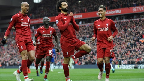 <p>               Liverpool's Mohamed Salah, center, celebrates with teammates after scoring his side's second goal during the English Premier League soccer match between Liverpool and Chelsea at Anfield stadium in Liverpool, England, Sunday, April 14, 2019. (AP Photo/Rui Vieira)             </p>
