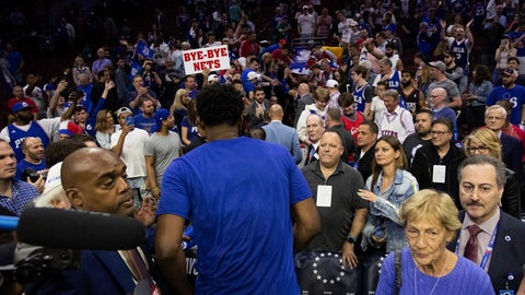 <p>               Philadelphia 76ers' Joel Embiid, of Cameroon, heads to the locker room following Game 5 of a first-round NBA basketball playoff series against the Brooklyn Nets, Tuesday, April 23, 2019, in Philadelphia. The 76ers won 122-100. (AP Photo/Chris Szagola)             </p>