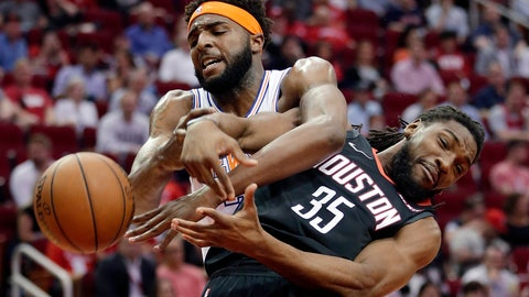 <p>               New York Knicks center Mitchell Robinson and Houston Rockets forward Kenneth Faried (35) both lose the ball on a rebound during the first half of an NBA basketball game Friday, April 5, 2019, in Houston. (AP Photo/Michael Wyke)             </p>