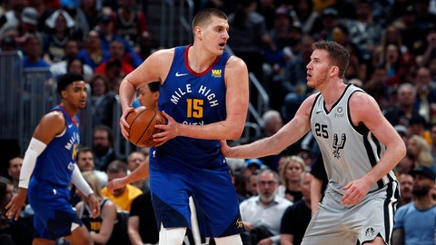 <p>               Denver Nuggets center Nikola Jokic (15) is pressured by San Antonio Spurs center Jakob Poeltl (25) in the first half of Game 5 of an NBA basketball first round playoff series, Tuesday, April 23, 2019, in Denver. (AP Photo/David Zalubowski)             </p>