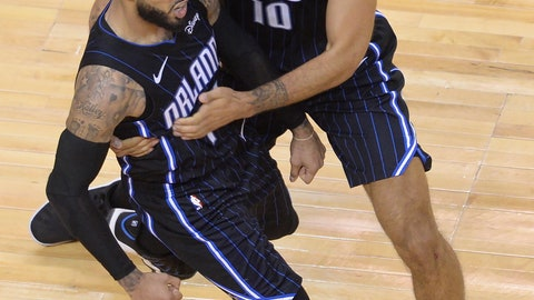 <p>               Orlando Magic guard D.J. Augustin (14) celebrates his game-winning three point basket with teammate Orlando Magic guard Evan Fournier (10) late the second half in Game 1 of a first-round NBA basketball playoff series in Toronto, Saturday, April 13, 2019. The Magic won 104-101. (Nathan Denette/The Canadian Press via AP)             </p>