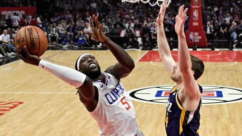 <p>               Los Angeles Clippers forward Montrezl Harrell, left, shoots as Utah Jazz forward Tyler Cavanaugh defends during the first half of an NBA basketball game Wednesday, April 10, 2019, in Los Angeles. (AP Photo/Mark J. Terrill)             </p>