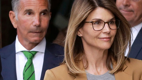 <p>               Actress Lori Loughlin, front, and husband, clothing designer Mossimo Giannulli, left, depart federal court in Boston on Wednesday, April 3, 2019, after facing charges in a nationwide college admissions bribery scandal. (AP Photo/Steven Senne)             </p>