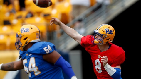 <p>               Pittsburgh quarterback Kenny Pickett (8) gets off a pass as offensive guard Rashad Wheelers looks to block during their annual intrasquad Blue-Gold spring NCAA college football game, Saturday, April 13, 2019, in Pittsburgh. (AP Photo/Keith Srakocic)             </p>