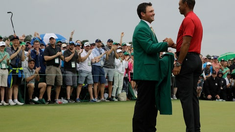 <p>               Patrick Reed helps Tiger Woods with his green jacket after Woods won the Masters golf tournament Sunday, April 14, 2019, in Augusta, Ga. (AP Photo/Charlie Riedel)             </p>