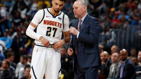 <p>               Denver Nuggets head coach Michael Malone, right, confers with guard Jamal Murray during a break in the action against the Portland Trail Blazers in the first half of Game 1 of an NBA basketball second-round playoff series Monday, April 29, 2019, in Denver. (AP Photo/David Zalubowski)             </p>