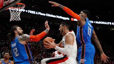 <p>               Portland Trail Blazers center Enes Kanter, center, grabs a rebound as Oklahoma City Thunder center Steven Adams, front left, and Thunder forward Paul George, right, defend during the second half of Game 1 of a first-round NBA basketball playoff series in Portland, Ore., Sunday, April 14, 2019. (AP Photo/Steve Dipaola)             </p>
