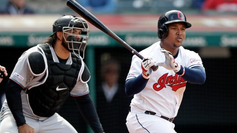 <p>               Cleveland Indians' Jose Ramirez, right, watches his ball after hitting a two-run double in the eighth inning of a baseball game against the Miami Marlins, Wednesday, April 24, 2019, in Cleveland. Jake Bauers and Francisco Lindor scored. Miami Marlins catcher Jorge Alfaro watches. The Indians won 6-2. (AP Photo/Tony Dejak)             </p>