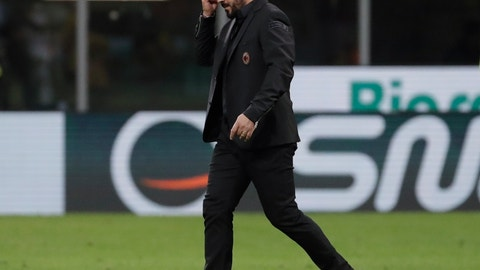 <p>               AC Milan coach Gennaro Gattuso leaves the pitch at the end of the Serie A soccer match between AC Milan and Udinese, at the San Siro stadium in Milan, Italy, Tuesday, April 2, 2019. (AP Photo/Luca Bruno)             </p>
