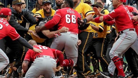 <p>               Cincinnati Reds' Yasiel Puig (66) is restrained by Pittsburgh Pirates bench coach Tom Prince, in the middle of a bench clearing brawl during the fourth inning of a baseball game in Pittsburgh, Sunday, April 7, 2019. (AP Photo/Gene J. Puskar)             </p>
