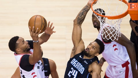 <p>               Toronto Raptors forward Norman Powell, left, drives to the net against Orlando Magic center Khem Birch (24) during the second half in Game 5 of a first-round NBA basketball playoff series, Tuesday, April 23, 2019 in Toronto. (Nathan Denette/Canadian Press via AP)             </p>