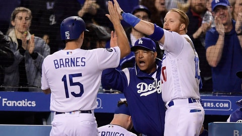 <p>               Los Angeles Dodgers' Austin Barnes, left, is congratulated by manager Dave Roberts, center, and Justin Turner after scoring on a double by David Freese during the seventh inning of a baseball game against the San Francisco Giants on Wednesday, April 3, 2019, in Los Angeles. (AP Photo/Mark J. Terrill)             </p>
