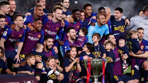 <p>               FC Barcelona players, with their children, pose with their trophy after winning the Spanish League title, at the end of the Spanish La Liga soccer match between FC Barcelona and Levante at the Camp Nou stadium in Barcelona, Spain, Saturday, April 27, 2019. Barcelona clinched the Spanish La Liga title, with three matches to spare, after it defeated Levante 1-0. (AP Photo/Manu Fernandez)             </p>