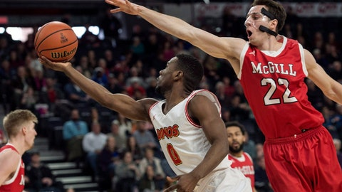 <p>               FILE - In this March 10, 2018 photo, Calgary's David Kapinga, left, shoots as McGill's Francois Bourque defends during the first half of in the semifinals of the men's basketball national championship in Halifax, Nova Scotia. McGill University has dropped the name Redmen from its varsity sports teams after receiving complaints that the name is a racial slur, Principal Suzanne Fortier said in a statement Friday, April 12, 2019. (Darren Calabrese/The Canadian Press via AP)             </p>